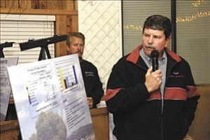 Courier/Jo. L. Keener Don Allison of the Monogram Development Services shows a graphic outlining the economic impact to the Town of Dewey-Humboldt with the development of the Young¹s Farm property during a zoning hearing Thursday night at the farm.