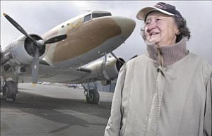Courier/Nathaniel Kastelic Irene Leverton, part of the ³Mercury 13² program, describes her past and experience flying a Douglas DC -3 similar to the one in the background Friday at the Prescott airport.