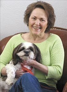 Courier/Jo. L. Keener Lenore Clark poses with Buster in her Prescott home on Tuesday, March 21.