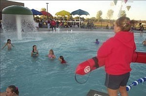 Courtesy photo/Salina Sialega A lifeguard watches over children swimming at the Chino Valley Aquatics Center in October.