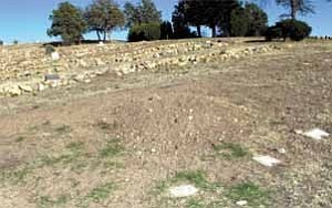 Courier/Nathaniel Kastelic This is the spot, above, in the Pioneers¹ Home Cemetery where the former Lincoln County, N.M., sheriff and others dug up and took bones that they hope belong to John Miller, who claimed to be Billy the Kid. The only authenticated photo of Billy the Kid is at left.