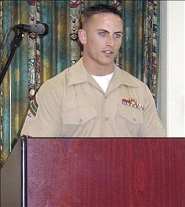 Courier/Rachelle Bump  Eric Hanley, who just returned home from Iraq, speaks to residents of Las Fuentes Resort Monday, about his experiences in combat.