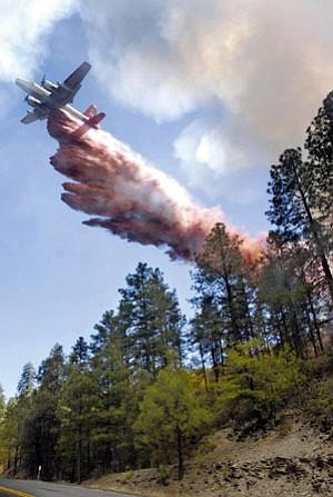 Prescott - June 1, 2006 Courier/Les Stukenberg Heavy Air Tanker No. 11 drops a load of retardant at the Green Fire near Walker, east of Prescott Thursday.
