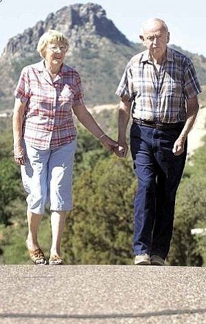 Courier/Nathaniel Kastelic Don Bolander, hikes one-and-a-half miles each day with his wife Kay, facilitator of the Prescott Parkinson¹s Support Group, to keep his Parkinson¹s disease from worsening and to stay flexible Friday morning in their Prescott neighborhood.