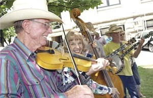 Courier/Nathaniel Kastelic Blaine Cone, left, Arizona Old Timer Fiddler Association member, plays with fellow ³jammers² at the 25th annual Prescott Bluegrass Festival on the courthouse plaza Saturday afternoon.