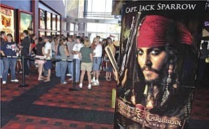 Courier/Nathaniel Kastelic A line forms Monday at a showing of ŒPirates of the Caribbean: Dead Man¹s Chest¹ at Harkins Theatres in Prescott Valley.