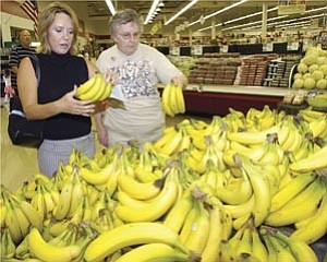 Courier/Les Stukenberg Lori Collison, left, and Dede Masterson try to find some green bananas as they shop for Masterson¹s groceries in Prescott Monday morning.