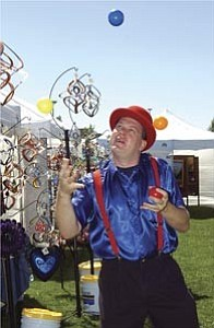James Reid, a juggler from Phoenix, performs Saturday during the annual Prescott Valley Art fifth Festival at the Civic Center.  Courier/Jo. L. Keener