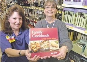 Courier/Nathaniel Kastelic Terri Kuykendall, left, and Jackie Phillips, both recipe winners of the Wal-Marts regional employee family cookbook contest, pose in the Wal-Mart off Gail Gardner Way in Prescott Thursday.