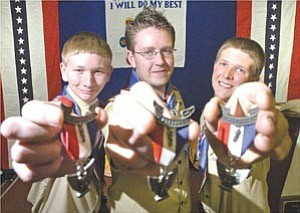 Courier/Nathaniel Kastelic Treguboff brothers Matt, left, 17, Jacob, 21, and Tim, 18, all with Troop 10, pose holding their Eagle Scout Awards at their Eagle Court of Honor at the Arizona National Guard Armory in Prescott Saturday.