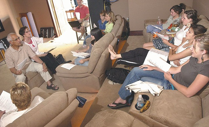 The Daily Courier/Nathaniel Kastelic --- Head leaders Bill DeLannoy, left, and his wife, Sharon, review cultural etiquette Sunday with Prescott-area team members who will be participating in the South Africa Mission July 11-30.