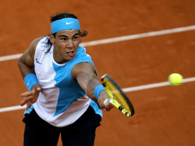 Defending champion Spain's Rafal Nadal volleys the ball to compatriot Albert Montanes during their third round match of the French Open tennis tournament at the Roland Garros stadium in Paris, Saturday June 2 , 2007. Nadal won 6-1, 6-3, 6-2. (AP Photo/David Vincent)