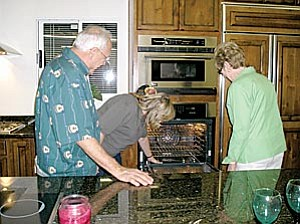 The Daiy Courier/Joanne C. Twaddell Customers Lanny and Carolyn Dickinson from Phoenix look at tri-vection ovens with Laura Delacruz (center), sales associate at Arizona Homes Centers in Prescott.