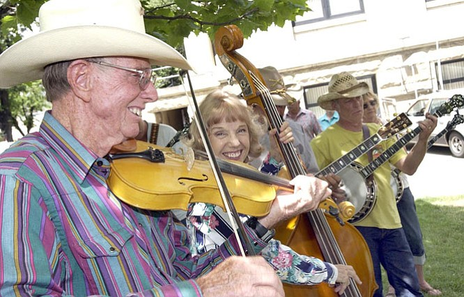 Courier/Nathaniel Kastelic ---  Doug Piper, left, plays 'Crying Holy to the Lord' with fellow 'Jammers' at the Prescott Bluegrass Festival Saturday afternoon.