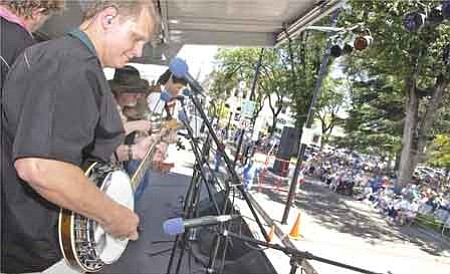 Mickey Stinnett, left, Jody Adams, Greg Reed and Dick Carlson of Palmer Divide perform at the 26th annual Prescott Bluegrass Festival at the courthouse plaza Saturday.