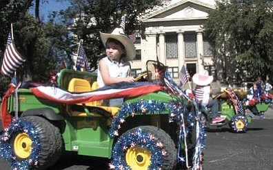 The Daily Courier/Les Stukenberg In this image taken from video, kids drive their tractors along Cortez Street in the 66th Annual Kiwanis Kiddie Parade in downtown Prescott. To see the whole video, go to www.dcourier.com and select the video tab.