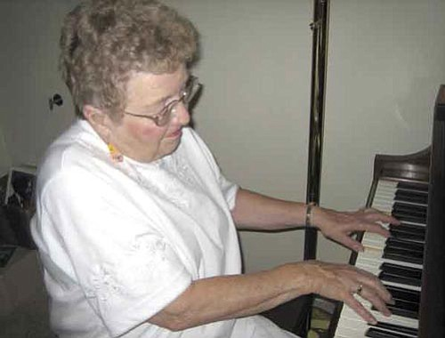 Pat Unkenholz plays the piano in celebration of her 77th birthday, on July 7, 2007.