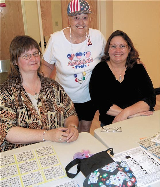 The Daily Courier/Derek Meurer From left to right: Linda Landrum, Maggie Mitchell and Samantha Carlson display that bingo paraphernalia before playing in the bingo games at The Adult Center of Prescott on June 5.