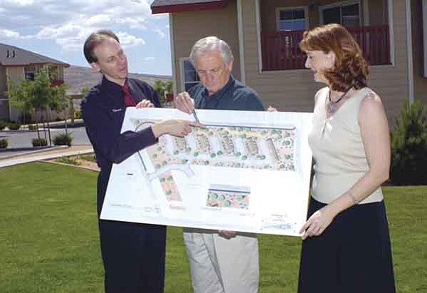 The Daily Courier/Jo. L. Keener Edward, left, Ed, center, and Krista Ruwaldt look at a rendering Thursday afternoon of a future expansion of the Glassford Hill Apartments. Phase two construction should start early next year.