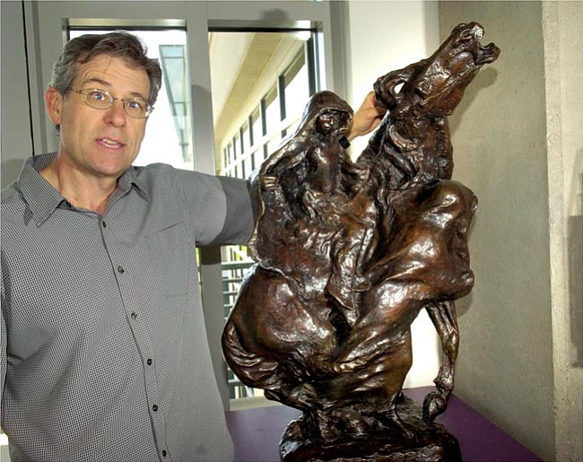 The Daily Courier/Jo. L. Keener  Rex Ijams, Prescott Valley's arts and cultural coordinator describes The Indian Love Chase, an 1899 bronze by Solon Borglum on the third floor of town hall.