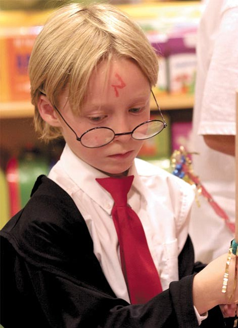 Jason Howard, 7, dressed up as Harry Potter for the Barnes and Noble new book release event.
