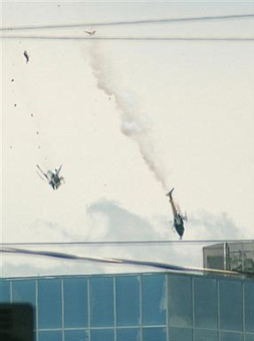 Two news helicopters fall after colliding in midair while covering a police pursuit in central Phoenix, Friday, killing everyone on both aircraft, police said. Both helicopters were from local television stations. KNXV-TV Channel 15 reported that one of the choppers belonged to its station. The other chopper was from KTVK Channel 3 in Phoenix. (AP Photo/La Voz-The Arizona Republic, AJ Alexander)