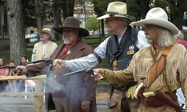 The Prescott Regulators group shoots it out on Whiskey Row Saturday morning. From left are Randy Hanks, alias George Ranz, Gene Manzer, alias Doc, and John Boyer, alias Johnnie Walker. The Regulators hosted the second annual Shootout on Whiskey Row with eight re-enactment groups from Arizona and California.