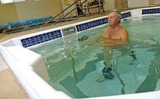 The Daily Courier/Nathaniel Kastelic Warren Mitchell walks on an underwater treadmill in the Hydroworxs therapy pool to exercise with his lower back pain at Peterson Physical Therapy in Prescott Wednesday.