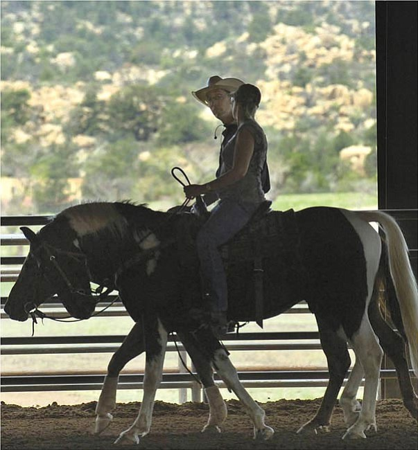 The Daily Courier/Jo. L. Keener  Ben Balow and a client appear in silhouette as they chat prior to the instructional clinic Saturday at The American Ranch. Balow presented a two-day clinic on basic horsemanship at the ranch.