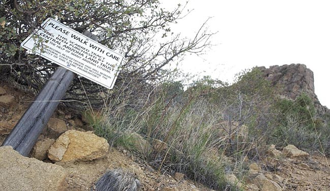 The Daily Courier/Nathaniel Kastelic Central Arizona Land Trust's sign advises hikers to use caution on a scarred Thumb Butte path that the organization is rehabilitating.