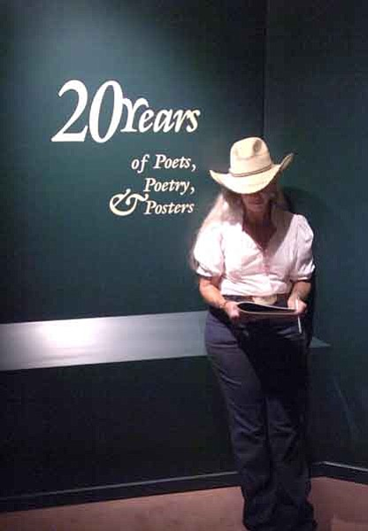 The Daily Courier/Jo. L. Keener  Mary Abbott of Rodeo, N.M., reviews material Friday afternoon at the  20th annual Arizona Cowboy Poets Gathering at Sharlot Hall Museum.