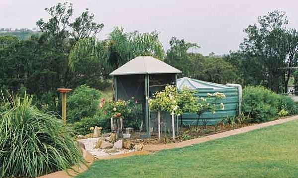 Rainwater catchment tanks, such as this one in Australia, represents an alternative water source for homeowners other than the precious resource of groundwater.