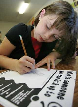 The Daily Courier/ Les Stukenberg  Kerriann Welker draws a picture of a person she looks up to as part of the Character Counts program in Jenene Woodruff's class at Mountain View Elementary School in Prescott Valley Tuesday morning.