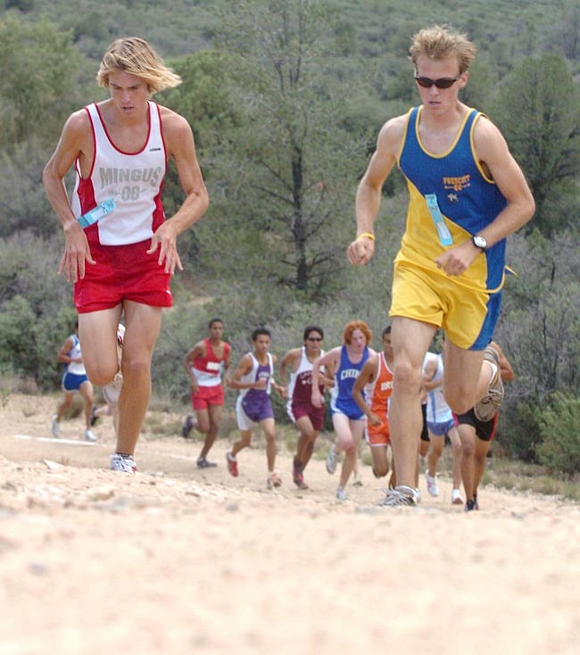 The Daily Courier/<br>Nathaniel Kastelic<br>Tim Freriks of Mingus, left, matches Prescott's Ben Schild step for step Saturday morning at Embry-Riddle. Friends off the course as well, Freriks edged Schild at the finish line.