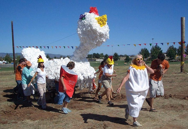 The Hot Chick team shows why it won the Best Team Spirit trophy in the 2006 Prescott Valley Kinetic Sculpture Race.