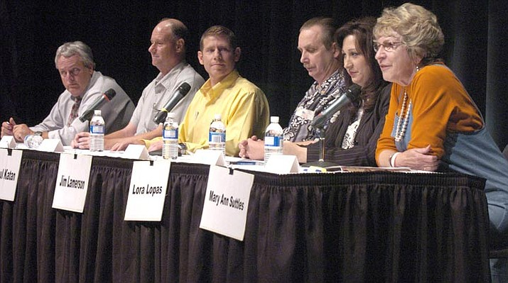 The Daily Courier/Nathaniel Kastelic --- Steve Blair, left, Alan Dubiel, Paul Katan, Jim Lamerson, Lora Lopas, and Mary Ann Suttles debate local issues at the Yavapai Performance Hall during a debate in August.