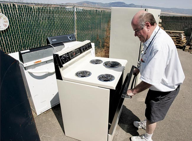 The Daily Courier/Les Stukenberg Owner Mike Castor of Mike's Appliance Center talks about turning used washers, dryers, stoves and refrigerators into scrap metal.