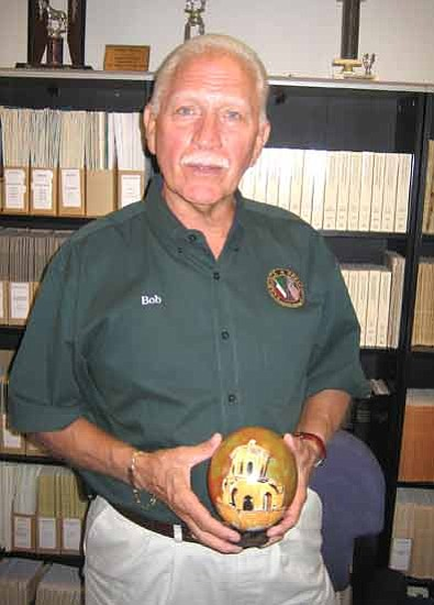 Bob Greninger, former president of the Sister City Association of Prescott, displays a hand-painted ostrich egg from Prescott's sister city of Caborca, Mexico. Courier/Ken Hedler