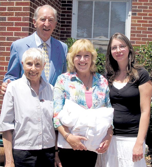 Ralph Weiger (back) poses with (left to right )Helen Cross, Alison White and Faith Megargee. White had a kidney transplant which brought together three generations of family and the community, as well. Weiger helped to arrange for her stay at the Arizona Transplant Home, her mother, Cross, acted as her caretaker before and after the operation, and Megargee, her daughter, donated the kidney that White received.