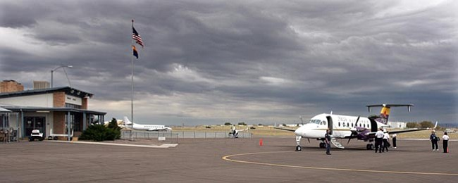 Phoenix passengers depart before Mesa Airlines' inaugural flight from Prescott to Las Vegas leaves Love Field Monday morning.