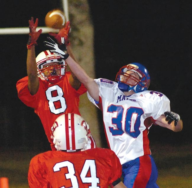 The Daily Courier/<br>Jo. L. Keener<br>Orme's A.J. Arzani picks off a pass while covering Mayer's Luke O'Sullivan in the first quarter Friday night at Orme School.