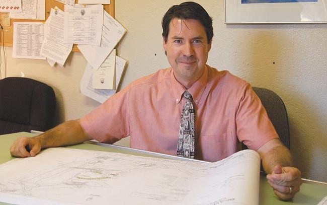 Yavapai County Development Services Floodplain Unit Manager Jeff Low reviews plans before developers can build in a floodplain.