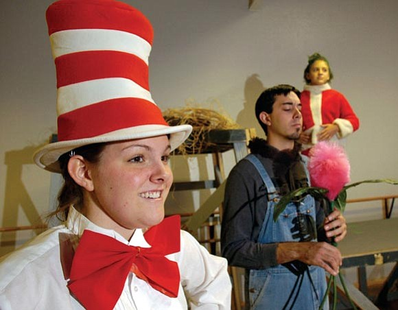 The Daily Courier/Jo. L. Keener --- Hannah Rothwell (foreground) plays the Cat in the Hat, who narrates the show. Patrick DuHaime and Renae Chriss co-star.