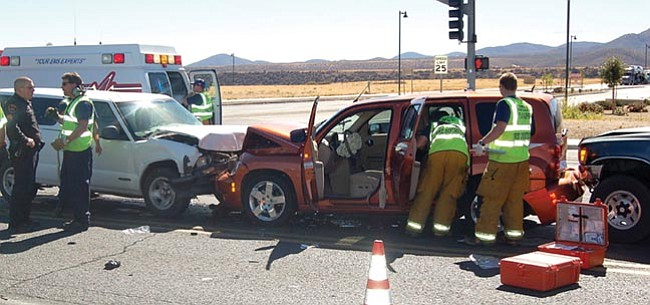 The Daily Courier/Lorin McLain Prescott Valley police and EMTs respond to a collision at the intersection of Highway 69 and Navajo Drive Tuesday morning.