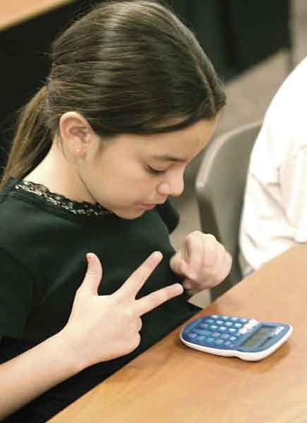 "The Daily Courier/Jo. L. Keener Nadine Juvera uses both fingers and a new calculator to complete her math quiz. Students in Humboldt Unified School District elementary schools used the new calculators to take the ""Sharp Minds Math Challenge."""