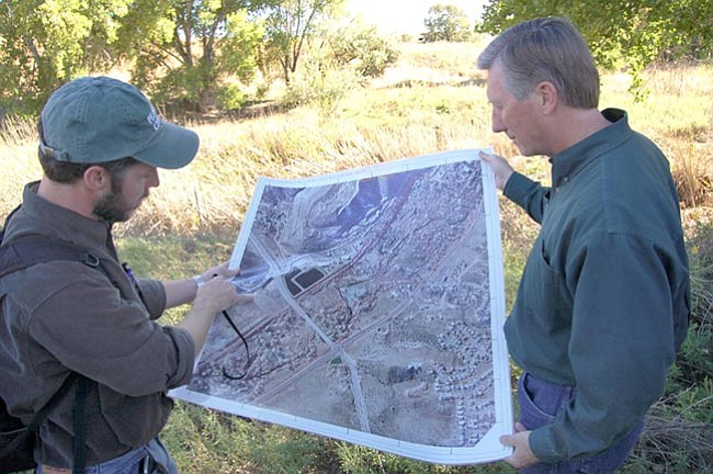 The Daily Courier/Doug Cook<br /><br /><!-- 1upcrlf2 -->Rolling out an aerial map, Prescott Creeks Preservation Association Executive Director Michael Byrd, left, points to a location near the Watson Woods Riparian Preserve as Arizona Department of Environmental Quality Director Steve Owens looks on. This past Thursday, Byrd led a small contingent including Owens and Prescott Mayor-Elect Jack Wilson, on a tour of the preserve that Prescott Creeks is refurbishing.