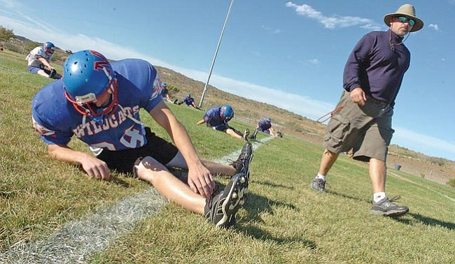 The Daily Courier/<br>Nathaniel Kastelic<br>Head coach Rick Lashley and the Wildcats are in do-or-die mode in the State playoffs.