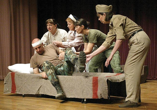 The Daily Courier/Les Stukenberg Members of the Prescott Stage Company perform a tribute of women veterans during the Women Veterans Recognition Ceremony Monday at the Bob Stump Veterans Affairs Medical Center in Prescott.