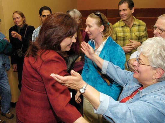 The Daily Courier/Jo. L. Keener Jo Anne Luzius embraces Lora Lopas after Lopas wins a runoff election Tuesday night.
