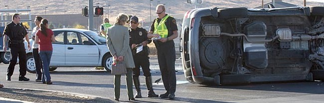 The Daily Courier/Jo. L. Keener Prescott Valley Police investigate a rollover accident at the intersection of Glassford Hill Road and Long Look Drive Tuesday afternoon.  Police detoured northbound Glassford Hill Road traffic onto Lakeshore Drive and Civic Circle, prompting heavy congestion on the side streets. The accident is still under investigation by PVPD.